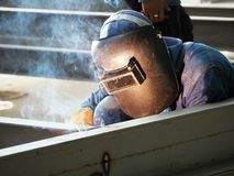 Welding worker with protective welding stock photos