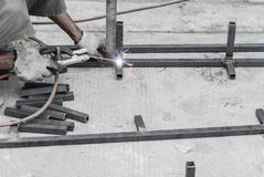 Welding worker using cutting torch to cut steel Royalty Free Stock Image