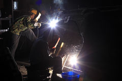 The welding workers. In the steel mill workshop, welding workers are working Royalty Free Stock Photos