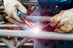 Welding workers who work with welding. Welding workers are skilled in the industry and are skilled Stock Image