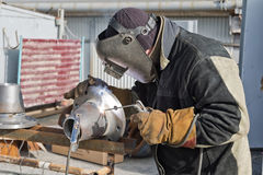Welding works on manufacturing of units and parts of pipelines Royalty Free Stock Images