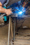 Welding in a workshop. Man welding in a workshop Royalty Free Stock Photography