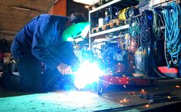 Welding in the workshop. Welder in work with welding in the workshop Stock Photo