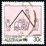 Welfare Australian Postage Stamp. AUSTRALIA - CIRCA 1988: A used postage stamp from Australia, depicting an illustration which symbolises Welfare and Living Royalty Free Stock Photography