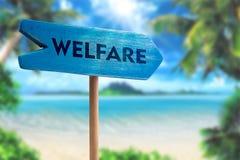Welfare sign board arrow. On beach with sunshine background stock photography