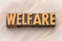 Welfare - word abstract in wood type. Welfare - word abstract in vintage letterpress wood type stock image