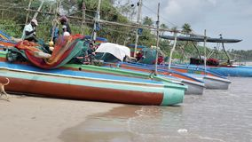 Weligama Fisherman Boat Ocean View Slowmotion 4kTypical Sri Lankan Road Slowmotion 4kWeligama Fisherman Boat Ocean Slowmotion 4k. Footage of some fishing boats stock video footage