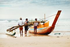 Weligama, Sri Lanka – December 21, 2017: Fishermen pushing the royalty free stock image