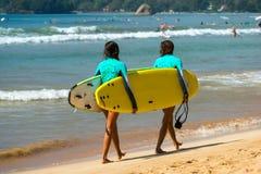 WELIGAMA, SRI LANKA - JANUARY 09 2017: Unidentified couple surfi Royalty Free Stock Image