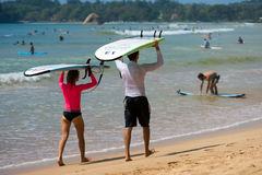 WELIGAMA, SRI LANKA - JANUARY 09 2017: Unidentified couple surfi Stock Photos