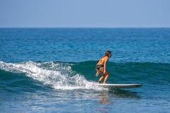 WELIGAMA, SRI LANKA - JANUARY 06, 2017: Unidentified woman surfi Stock Photo