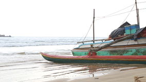 WELIGAMA, SRI LANKA - MARCH 2014: Boat on the beach in Weligama. The term Weligama literally means 'sandy village' which refers to stock video footage