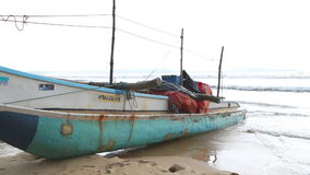 WELIGAMA, SRI LANKA - MARCH 2014: Boat on the beach in Weligama. The term Weligama literally means 'sandy village' which refers to stock footage