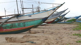 WELIGAMA, SRI LANKA - MARCH 2014: View of wooden fishing boats on beach. The term Weligama literally means 'sandy village' which r stock footage
