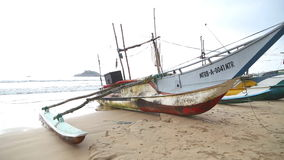 WELIGAMA, SRI LANKA - MARCH 2014: View of wooden fishing boats on beach. The term Weligama literally means 'sandy village' which r stock video footage
