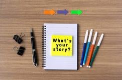 Welke ` s uw verhaal op blocnote stock foto