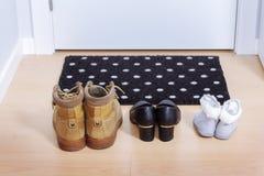 Welkom huis op zwarte mat Royalty-vrije Stock Fotografie