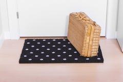 Welkom huis op zwarte mat Stock Foto