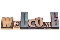 Welkom teken in gemengd houten type Stock Foto's