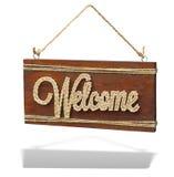 Welkom uitstekend bruin roestig houten teken op een witte achtergrond royalty-vrije stock fotografie