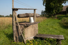 Well. Vintage wooden well in the countryside Royalty Free Stock Photography