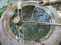 Well. Japanese well and fountain with a bamboo dipper stock photo