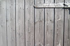 Well aged wooden planks - door with hinge Stock Photo
