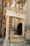 Well & archway with lions, Monetpulciano Italy Royalty Free Stock Photo