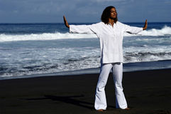 Well being 1. Well being on a black sand beach Royalty Free Stock Photography