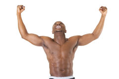 Well-built muscular black man with arms raised Stock Images