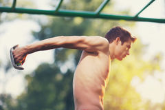 Well built muscular man doing a physical exercise Royalty Free Stock Photo