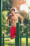 Well built muscular man doing a physical exercise Stock Photography