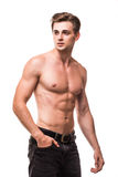 Well built shirtless muscular male model against white background. Portrait of a well built shirtless muscular male model against white background Royalty Free Stock Photography