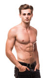 Well built shirtless muscular male model against white background. Portrait of a well built shirtless muscular male model against white background Royalty Free Stock Images