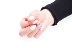 Well cared woman's hands on white with well painted fingernails Stock Photos