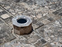 Well in the center of a spanish-colonial style plaza in Mexico stock images