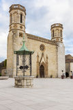 A well and a church in Southern France Royalty Free Stock Photo