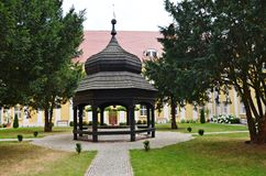 Well. The well in the churchyard in the Monastery of Gostyn, Poland Royalty Free Stock Image
