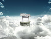 Well on clouds royalty free stock photo