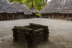Well and cottage in Biskupin museum - Poland. Royalty Free Stock Images