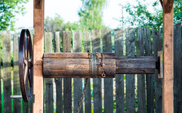 Well crank with hawser rope. Wooden Well crank with the hawser rope Stock Image