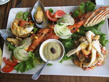 Well decorated seafood. Served and well decorated plate of seafood Stock Images