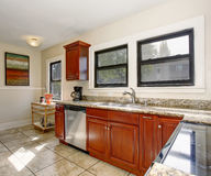 Well defined kitchen with large tile floor. Royalty Free Stock Photography