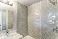 Well designed bathroom with mosaic tiled wall. Well designed bathroom interior with mosaic tiled wall royalty free stock photography