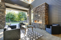 Well designed covered patio boasts stone fireplace Stock Images