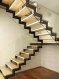 Well designed stairs. Modern designed stairs made with wood and glass Stock Photos