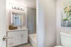 Well designed bathroom with mosaic tiled wall. Well designed white bathroom with mosaic tiled wall stock photos