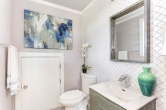 Well designed bathroom with mosaic tiled wall. Well designed white bathroom with mosaic tiled wall stock photo