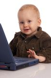Well done. Toddler-boy with  laptop smiling happily Stock Photo