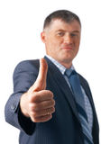 Well Done!. Elder business executive showing OK sign on white background Royalty Free Stock Image